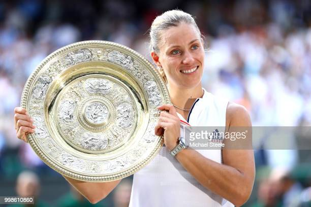 Angelique Kerber of Germany poses with the Venus Rosewater Dish after defeating Serena Williams of The United States in the Ladies' Singles final on...