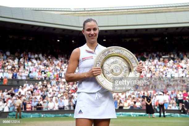 Angelique Kerber of Germany poses with The Venus Rosewater Dish after winning the Ladies Singles final against Serena Williams of The United States...