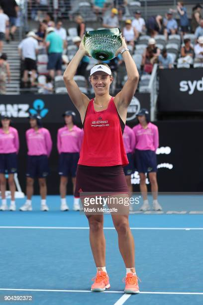 Angelique Kerber of Germany poses with the winners trophy after the Women's Singles Final match against Ashleigh Barty of Australia during day seven...