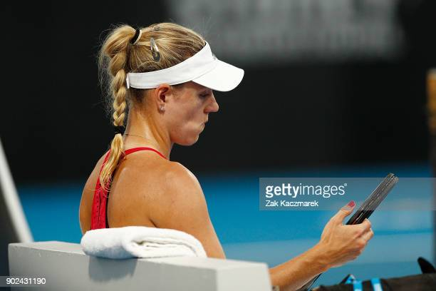 Angelique Kerber of Germany reacts after losing the first set in a tie break in her first round match against Lucie Safarova of Czech Republic during...