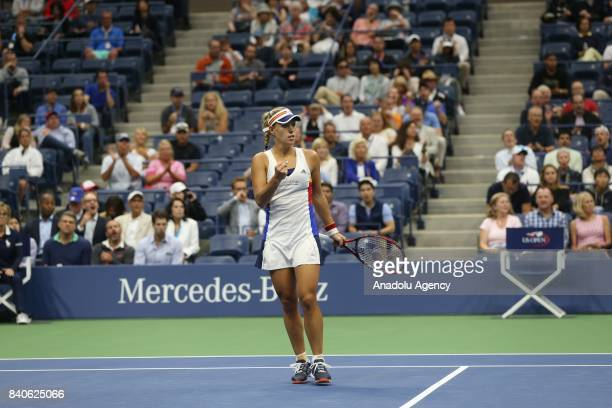 Angelique Kerber of Germany reacts during her women's singles match against Naomi Osaka of Japan within 2017 US Open Tennis Championships at Arthur...