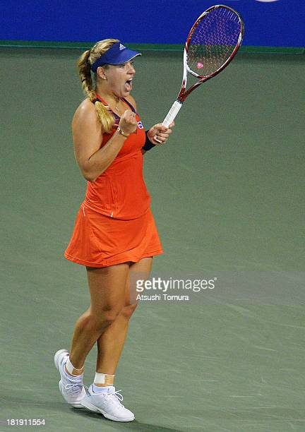 Angelique Kerber of Germany reacts during her women's singles quarter final match against Agnieszka Radwanska of Poland during day five of the Toray...