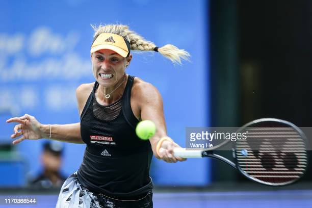 Angelique Kerber of Germany reacts during the match against Monica Puig of Puerto Rico on Day 2 of 2019 Dongfeng Motor Wuhan Open at Optics Valley...