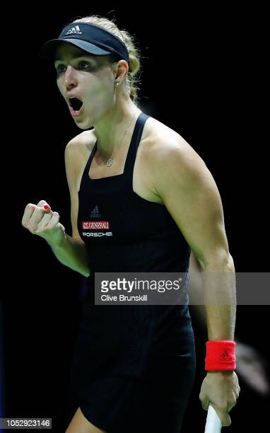Angelique Kerber of Germany reacts to a point in her women's singles match against Naomi Osaka of Japan during day 4 of the BNP Paribas WTA Finals...