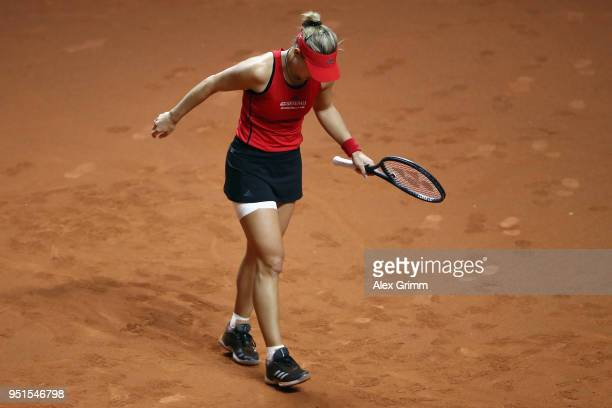 Angelique Kerber of Germany reacts to an injury during her match against Anett Kontaveit of Estonia during day 4 of the Porsche Tennis Grand Prix at...