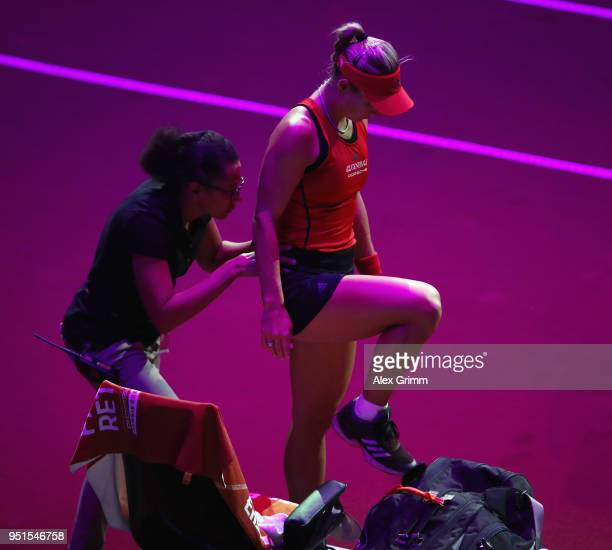 Angelique Kerber of Germany Receives treatment during her match against Anett Kontaveit of Estonia during day 4 of the Porsche Tennis Grand Prix at...