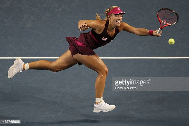 Angelique Kerber of Germany returns a shot against Ana Ivanovic of Serbia during their women's singles semifinal match on day six of the Toray Pan...