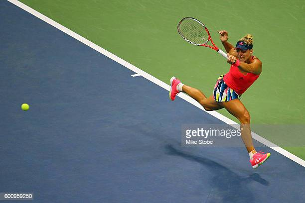 Angelique Kerber of Germany returns a shot against Caroline Wozniacki of Denmark during their Women's Singles Semifinal Match on Day Eleven of the...