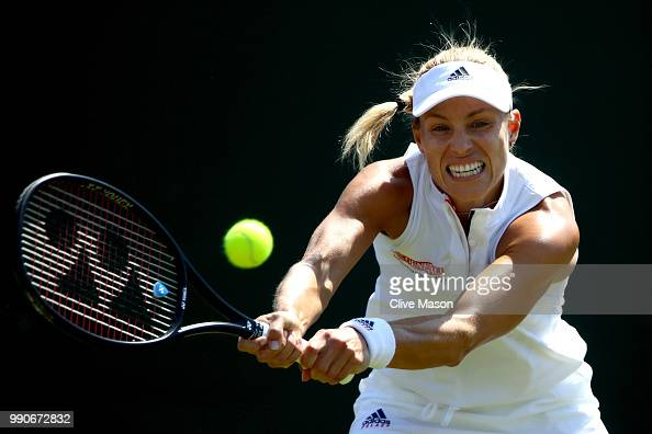 Angelique Kerber of Germany returns a shot against Vera Zvonareva of Russia during their Ladies' Singles first round match on day two of the...