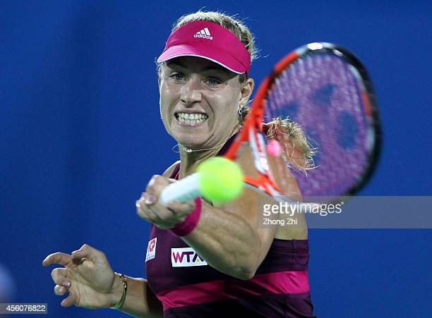 Angelique Kerber of Germany returns a shot during her match against Elina Svitolina of Ukraine on day five of 2014 Dongfeng Motor Wuhan Open at...