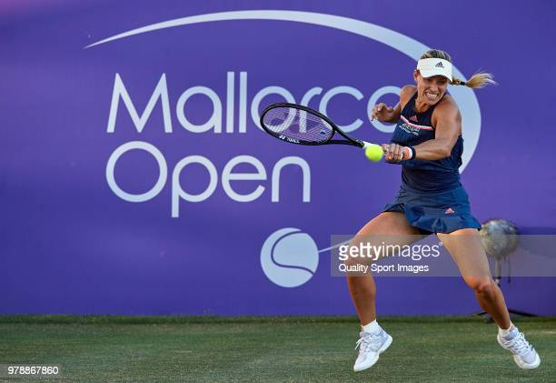 Angelique Kerber of Germany returns a shot during her match against Alison Riske of USA during day two of the Mallorca Open at Country Club Santa...