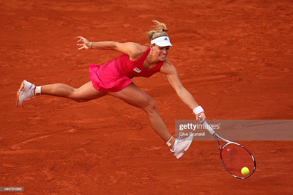 Angelique Kerber of Germany returns a shot during her women's singles match against Daniela Hantuchova of Slovakia on day six of the French Open at Roland Garros on May 30, 2014 in Paris, France.