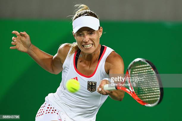 Angelique Kerber of Germany returns a shot during the women's singles semifinal match against Madison Keys of the United States on Day 7 of the Rio...