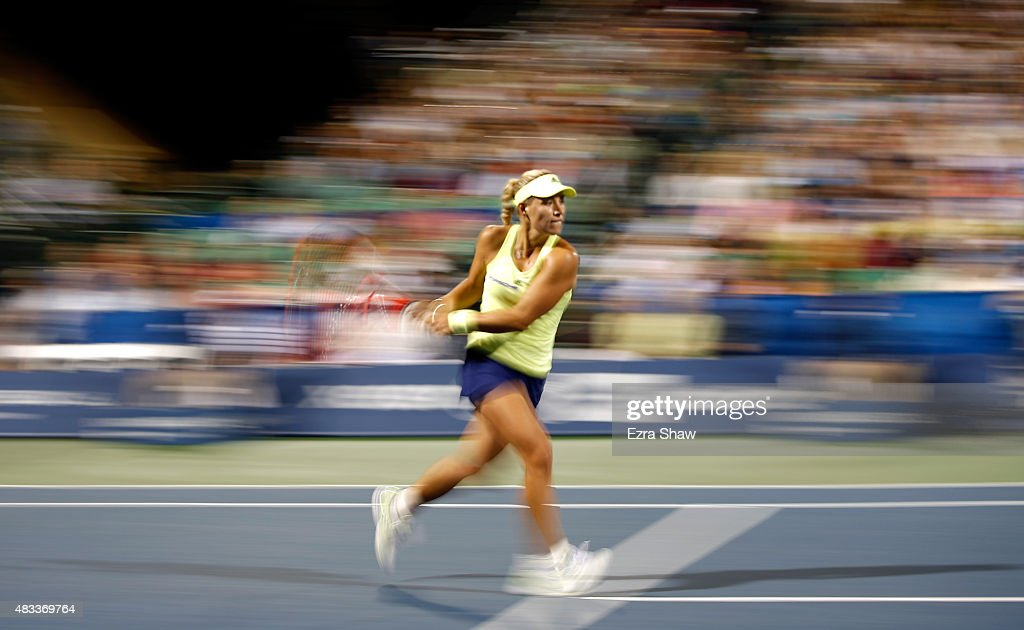 Angelique Kerber of Germany returns a shot to Agnieszka Radwanska of Poland during Day 5 of the Bank of the West Classic at Stanford University Taube Family Tennis Stadium on August 7, 2015 in Stanford, California.