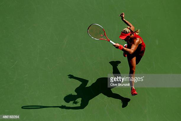 Angelique Kerber of Germany returns a shot to Alexandra Dulgheru of Romania during their Women's Singles First Round match on Day Two of the 2015 US...