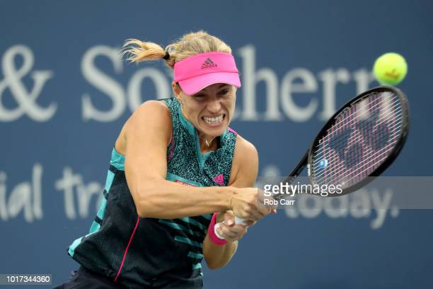 Angelique Kerber of Germany returns a shot to Anastasia Pavlyuchenkova of Russia during Day 5 of the Western and Southern Open at the Lindner Family...