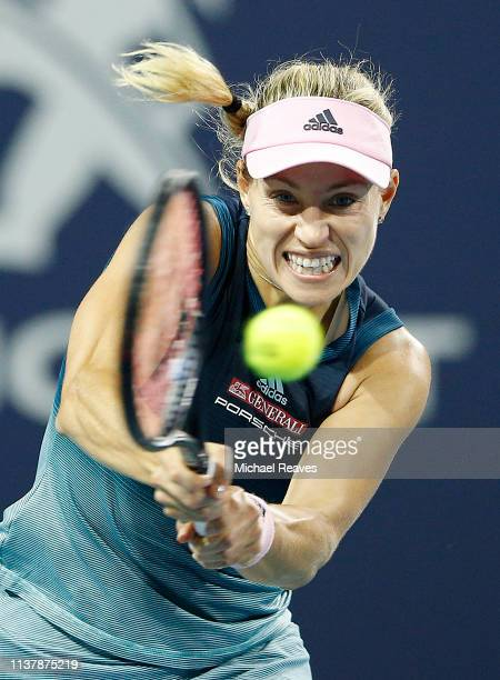 Angelique Kerber of Germany returns a shot to Bianca Andreescu of Canada during Day 6 of the Miami Open Presented by Itau at Hard Rock Stadium on...