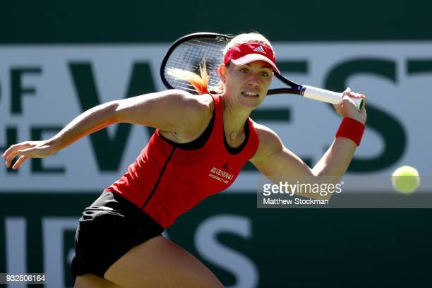 Angelique Kerber of Germany returns a shot to Daria Kasatkina of Russia during the quarterfinals of the BNP Paribas Open at the Indian Wells Tennis...