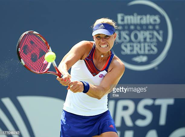 Angelique Kerber of Germany returns a shot to Elena Vesnina of Russia during Day Three of the New Have Open at Connecticut Tennis Center at Yale on...