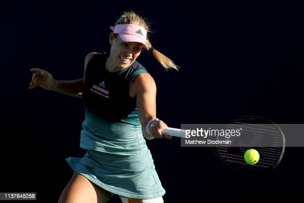 Angelique Kerber of Germany returns a shot to Karolina Muchova of Czech Republic during the Miami Open Presented by Itau at Hard Rock Stadium March...