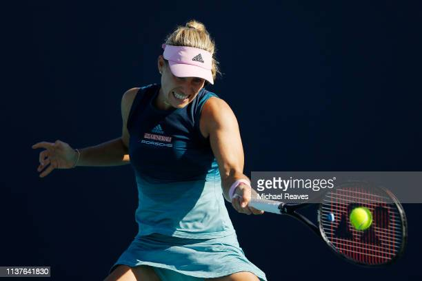 Angelique Kerber of Germany returns a shot to Karolina Muchova of the Czech Republic during Day 5 of the Miami Open Presented by Itau at Hard Rock...