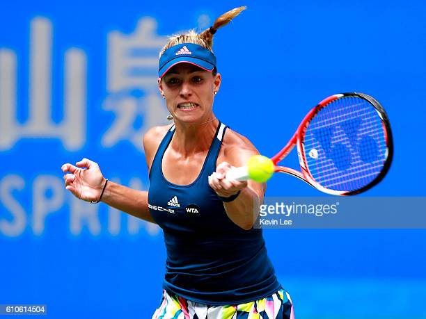 Angelique Kerber of Germany returns a shot to Kristina Mladenovic of France during their third round match on Day three of the 2016 Dongfeng Motor...