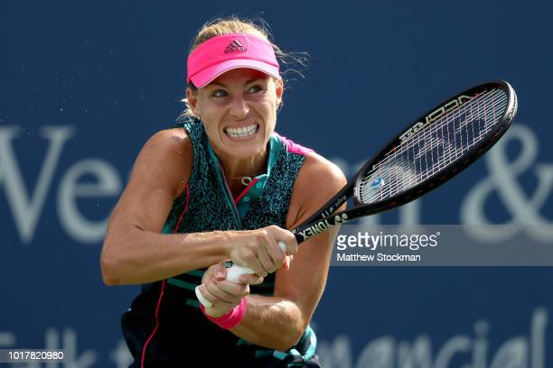 Angelique Kerber of Germany returns a shot to Madison Keys during the Western Southern Open at Lindner Family Tennis Center on August 16 2018 in...