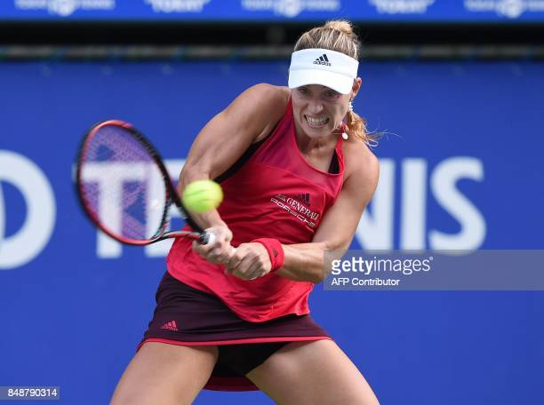 Angelique Kerber of Germany returns a shot to Naomi Osaka of Japan during the first round match of the Pan Pacific Open tennis tournament in Tokyo /...