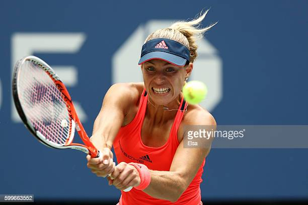 Angelique Kerber of Germany returns a shot to Roberta Vinci of Italy during their Women's Singles Quarterfinal Match on Day Nine of the 2016 US Open...