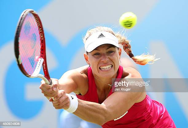 Angelique Kerber of Germany returns against Caroline Wozniacki of Denmark during their singles match on day seven of the Aegon International at...