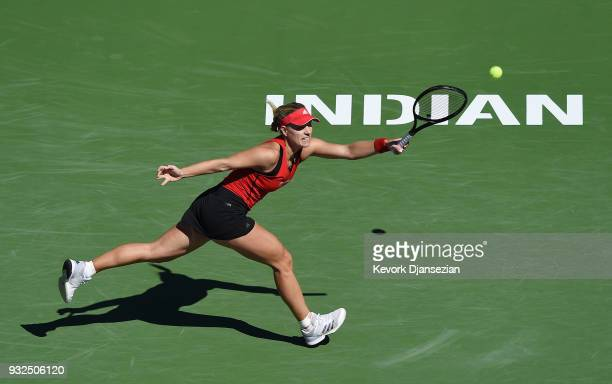 Angelique Kerber of Germany returns against Daria Kasatkina of Russia during Day 9 of BNP Paribas Open on March 15 2018 in Indian Wells California