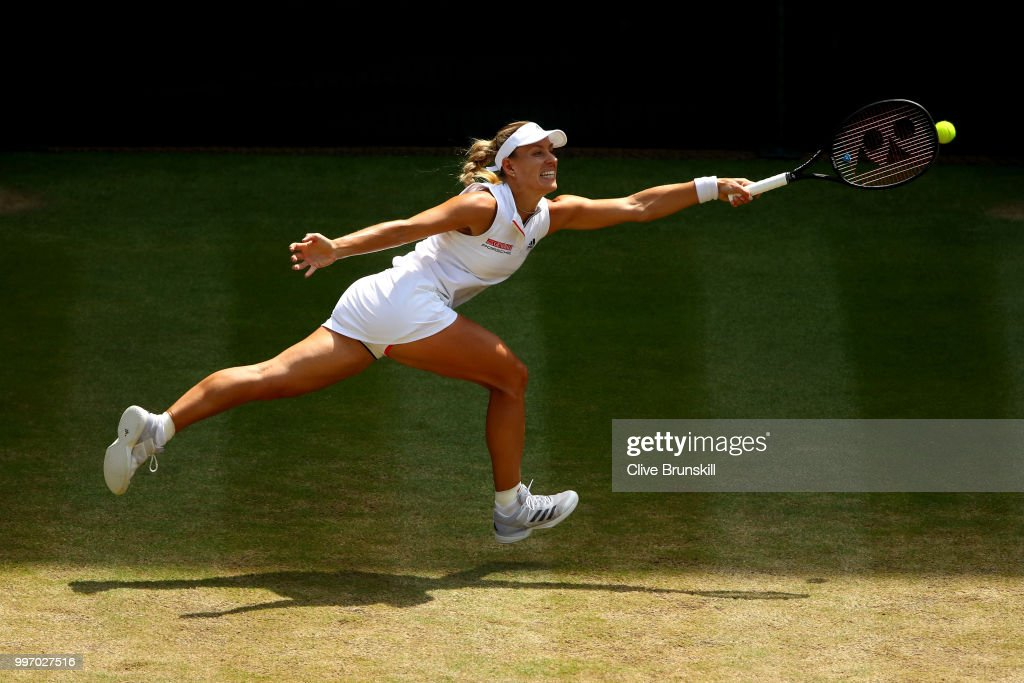 Angelique Kerber of Germany returns against Jelena Ostapenko of Latvia during their Ladies' Singles semi-final match on day ten of the Wimbledon Lawn Tennis Championships at All England Lawn Tennis and Croquet Club on July 12, 2018 in London, England.