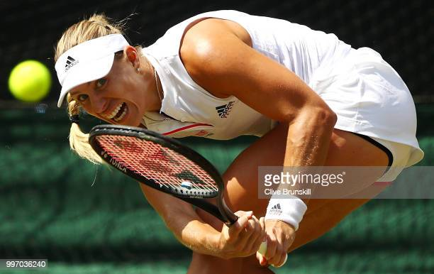 Angelique Kerber of Germany returns against Jelena Ostapenko of Latvia during their Ladies' Singles semifinal match on day ten of the Wimbledon Lawn...