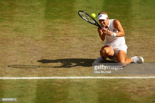 Angelique Kerber of Germany returns against Serena Williams of The United States during the Ladies' Singles final on day twelve of the Wimbledon Lawn...