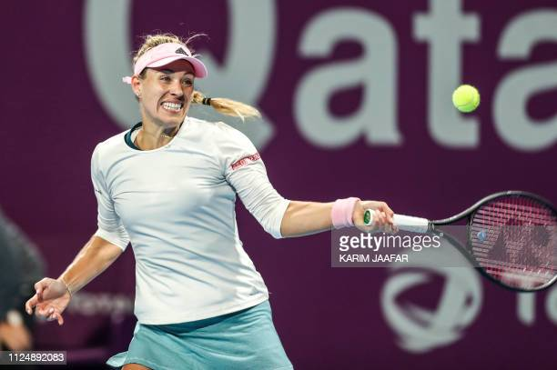Angelique Kerber of Germany returns the ball during her WTA Qatar Open quarterfinal tennis match against Barbora Strycova of the Czech Republic in...