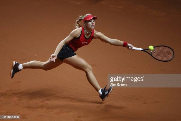Angelique Kerber of Germany returns the ball to Anett Kontaveit of Estonia during day 4 of the Porsche Tennis Grand Prix at PorscheArena on April 26...