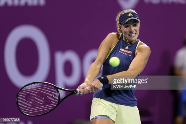 Angelique Kerber of Germany returns the ball to Caroline Wozniacki of Denmark during their singles match in the quarterfinal round of the Qatar Open...