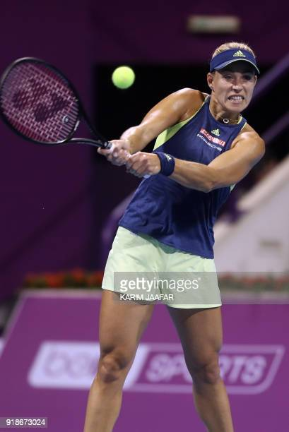 Angelique Kerber of Germany returns the ball to Johanna Konta of Great Britain as they compete in their singles match during the third round of the...