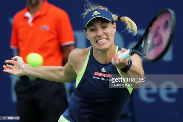 Angelique Kerber of Germany returns the ball to Karolina Pliskova of Czech Republic during their quarterfinal tennis match in the WTA Dubai Duty Free...