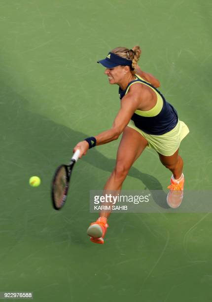 Angelique Kerber of Germany returns the ball to Karolina Pliskova of the Czech Republic during the quarterfinal tennis match in the WTA Dubai Duty...