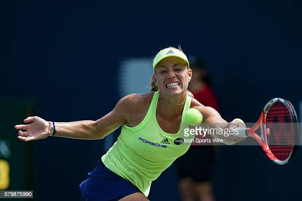 Angelique Kerber of Germany returns the ball to Simona Halep of Romania during their Round 3 match of the Rogers Cup tournament at the Aviva Centre...