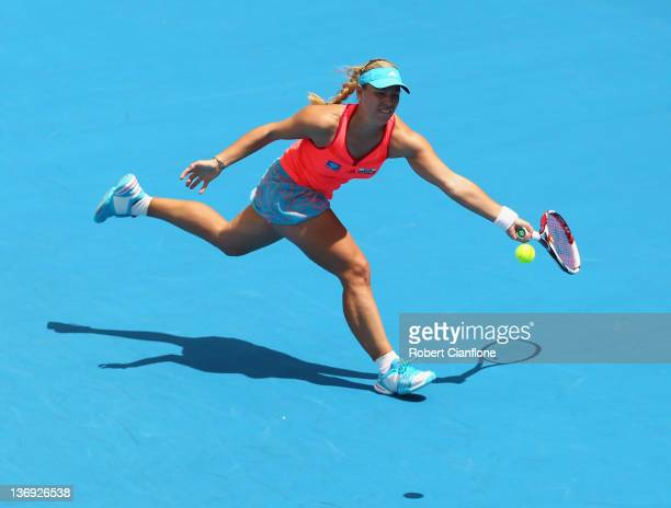 Angelique Kerber of Germany returs a shot to Mona Barthel of Germany during the singles semi final match on day six of the 2012 Hobart International...