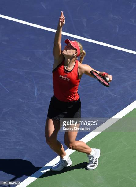 Angelique Kerber of Germany serves against Daria Kasatkina of Russia during Day 9 of BNP Paribas Open on March 15 2018 in Indian Wells California