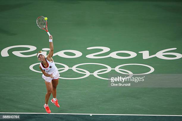 Angelique Kerber of Germany serves during the women's singles semifinal match against Madison Keys of the United States on Day 7 of the Rio 2016...