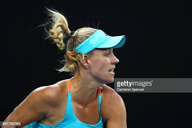Angelique Kerber of Germany serves in her first round match against Lesia Tsurenko of the Ukraine on day one of the 2017 Australian Open at Melbourne...