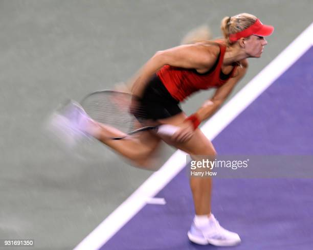 Angelique Kerber of Germany serves in her match against Caroline Garcia of France during the BNP Paribas Open at the Indian Wells Tennis Garden on...