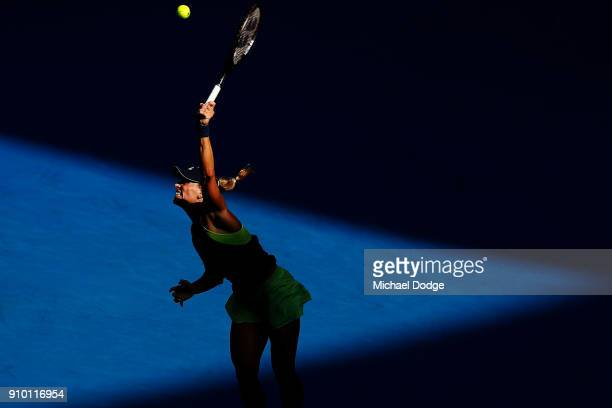 Angelique Kerber of Germany serves in her semifinal match against Simona Halep of Romania on day 11 of the 2018 Australian Open at Melbourne Park on...
