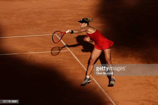 Angelique Kerber of Germany serves in their ladies singles third round match against Jesena Ostapenko of Latvia during Day Six of the Internazionali...