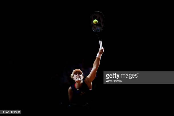Angelique Kerber of Germany serves the ball to Andrea Petkovic of Germany during their round of 16 match on day 4 of the Porsche Tennis Grand Prix at...