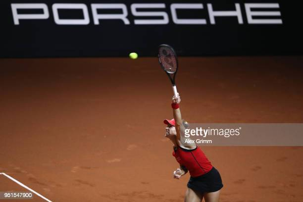 Angelique Kerber of Germany serves the ball to Anett Kontaveit of Estonia during day 4 of the Porsche Tennis Grand Prix at PorscheArena on April 26...